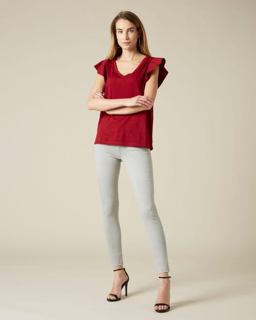 THE SKINNY CROP COLORED SLIM ILLUSION PEARL WITH RAW CUT