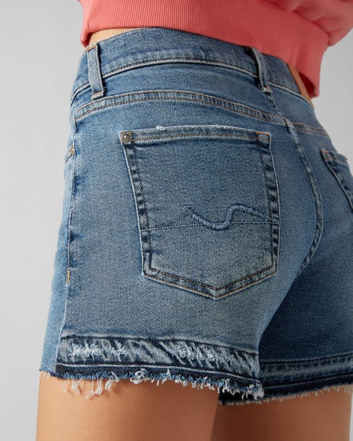 7 For All Mankind - Mid Rise Shorts Luxe Vintage Capitola Mid Indigo With Raw Cut And Back Unrolled Hem